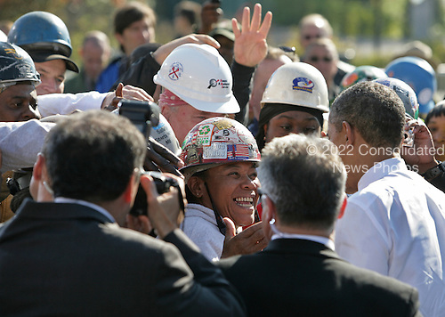 United States President Barack Obama shakes hands with construction workers following his remarks at Georgetown Waterfront Park, where he urged Congress to pass the infrastructure piece of the American Jobs Act, in Washington, Wednesday, November 2, 2011..Credit: Martin Simon / Pool via CNP