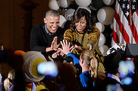 United States President Barack Obama and first lady Michelle Obama check hands with kids during a Halloween event in the East Room of the White House October 31, 2016 in Washington, DC. The first couple hosted local children and children of military families for trick-or-treating at the White House.<br /> Credit: Olivier Douliery / Pool via CNP /MediaPunch
