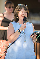 NWA Democrat-Gazette/CHARLIE KAIJO Kelly Syer, executive director of the Downtown Springdale Alliance, speaks to dinner guests, Saturday, June 9, 2018 on Emma Ave. in Springdale. &quot;This is all about community, bringing people together who know each other and don&acirc;&euro;&trade;t know each other, sitting down for a delicious meal and enjoying and celebrating community,&quot; she said. <br /><br />Back for its 3rd year, this popular event brought hundreds of guests together for a lively, friendly community dinner of multiple courses served under the night sky&acirc;&euro;&rdquo;right down the middle of Emma Avenue. Past attendees raved about the special experience of dining al fresco with family and friends, as well as meeting new neighbors.