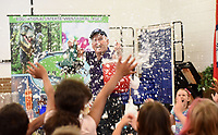 NWA Democrat-Gazette/FLIP PUTTHOFF <br />SNOW IN JUNE<br />Steve Cox, presenter of Super Science educational education programs, showers students at Eastside Elementary in Rogers with snow he created Tuesday June 5 2018 with carbon dioxide and liquid soap.  Cox did several experiments for students including making students' hair stand on end with static electricity, forming tornadoes in soda bottles, and using a chemical reaction to create a giant ice cream cone. The experiments taught students about the types of matter, evaporation and different types of gasses.