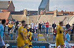 Newport County 1 Exeter City 1, 16/03/2014. Rodney Parade, League Two. Newport County finally return to the Football league after years of turmoil but a poor run of results has dented hopes of reaching the play-offs while Exeter City battle relegation. County fans on the Town (North) Terrace. Photo by Simon Gill
