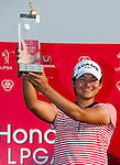 CHON BURI, THAILAND - FEBRUARY 20:  Yani Tseng of Taiwan celebrates with the trophy after winning the LPGA Thailand at Siam Country Club on February 20, 2011 in Chon Buri, Thailand. Photo by Victor Fraile / The Power of Sport Images