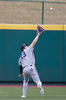 Luke Dauch (23) of the Northwestern Wildcats attempts to catch a ball in center field during a game against the Missouri State Bears at Hammons Field on March 9, 2013 in Springfield, Missouri. (David Welker/Four Seam Images)