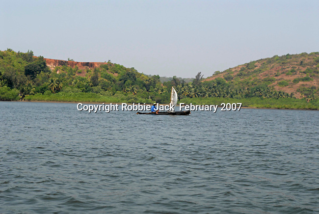 Man fishing from dugout canoe on the Chapora River in Goa in India.