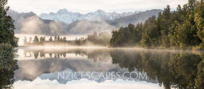 Dawn reflections of Mount Tasman and  Aoraki, Mount Cook of Southern Alps in Lake Matheson, Westland Tai Poutini National Park, West Coast, UNESCO World Heritage Area, South Westland, New Zealand, NZ