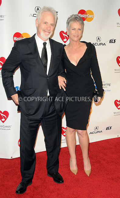 WWW.ACEPIXS.COM . . . . . ....February 11 2011, Los Angeles....Producer Pieter Jan Brugge and actress Jamie Lee Curtis arriving at the 2011 MusiCares Person of the Year Tribute to Barbra Streisand at the Los Angeles Convention Center on February 11, 2011 in Los Angeles, CA....Please byline: PETER WEST - ACEPIXS.COM....Ace Pictures, Inc:  ..(212) 243-8787 or (646) 679 0430..e-mail: picturedesk@acepixs.com..web: http://www.acepixs.com