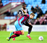 Lincoln City's John Akinde vies for possession with  Scunthorpe United's Charlie Goode<br /> <br /> Photographer Andrew Vaughan/CameraSport<br /> <br /> The EFL Checkatrade Trophy Northern Group H - Scunthorpe United v Lincoln City - Tuesday 9th October 2018 - Glanford Park - Scunthorpe<br />  <br /> World Copyright &copy; 2018 CameraSport. All rights reserved. 43 Linden Ave. Countesthorpe. Leicester. England. LE8 5PG - Tel: +44 (0) 116 277 4147 - admin@camerasport.com - www.camerasport.com
