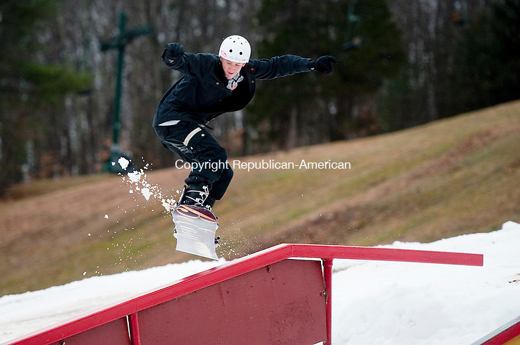 WOODBURY, CT--- -122615JS04--Tristan Cornelis of New Milford gets some air before grinding the rail while snowboarding Saturday at the Woodbury Ski Area in Woodbury. <br /> Jim Shannon Republican-American
