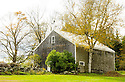 A classic New England barn is pictured in this autumn scene.