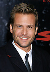 "HOLLYWOOD, CA. - December 17: Actor Gabriel Macht arrives at the Los Angeles premiere of ""The Spirit"" at the Grauman's Chinese Theater on December 17, 2008 in Hollywood, California."