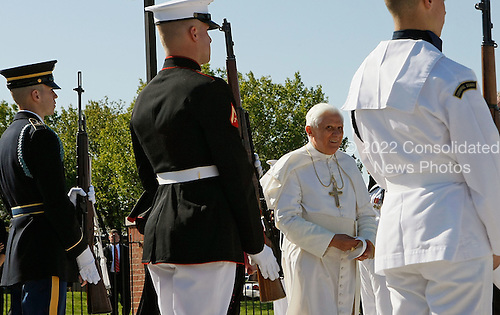CAMP SPRINGS, MD - APRIL 15:  (AFP OUT)  Pope Benedict XVI walks by an honor guard before departing Andrews Air Force Base, April 15, 2008 in Camp Springs, Maryland. On Wednesday Pope Benedict XVI will visit the White House and on Thursday he will he will say Mass at the Nationals Baseball stadium.   (Photo by Mark Wilson-Pool/Getty Images)  (Photo by Mark Wilson/Getty Images)
