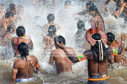"Altamira, Brazil. ""Xingu Vivo Para Sempre"" protest meeting about the proposed Belo Monte hydroeletric dam and other dams on the Xingu river and its tributaries. Kayapo Indian warriors blessing the waters of the river."