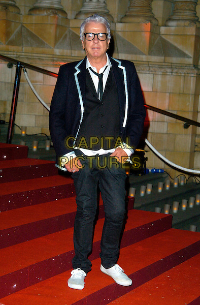 NICKY HASLAM.The Cartier VIP gala dinner, Natural History Museum, London, England..October 17th, 2007.full length black jacket grey gray trousers blue waistcoat glasses white trainers sneakers hand in pocket.CAP/CAN.©Can Nguyen/Capital Pictures