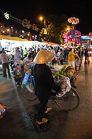 Dalat Night Market   The vendors display their goods from 5 p.m. and when the buyers start to wander in, the sellers shout out their specials, trying to attract shoppers attention. The market sells mainly clothing at surprisingly cheap prices as well as a large variety of food and snacks.  The streets at the Dalat Night Market is lit up with neon lights from the shops in the street sides. Canvas is spread on the streets to display all the things for sale, giving the market a festive atmosphere.