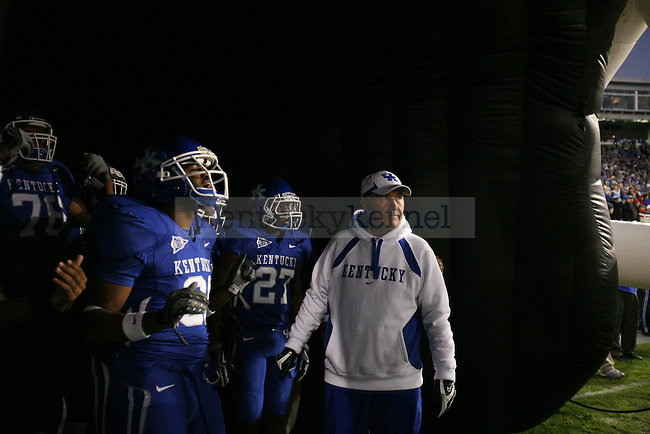 Coach Brooks waits with the UK football team to run out onto the field. UK plays Louisiana-Monroe at Commonwealth Stadium on Saturday, Oct. 24, 2009. Photo by Adam Wolffbrandt | Staff
