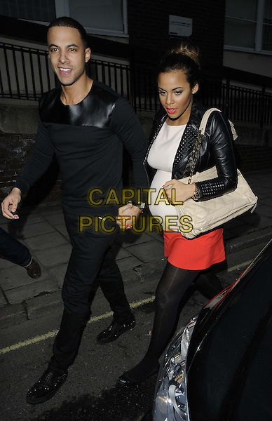 "Marvin Humes of JLS & Rochelle Wiseman Humes.The ""Streets : A New Kind of Musical"" VIP night, The Cockpit Theatre, London, England..April 9th, 2013.full length black top jeans denim leather jacket white red dress beige bag purse married husband wife pregnant holding hands tights.CAP/CAN.©Can Nguyen/Capital Pictures."