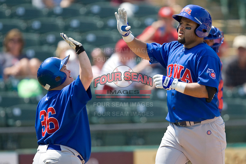 Iowa Cubs catcher Max Ramirez (20) is greeted by the bat boy following his HR against the Round Rock Express on April 10th, 2011 at Dell Diamond in Round Rock, Texas.  (Photo by Andrew Woolley / Four Seam Images)