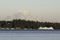 July 17, 2003 : A Washington State Ferry could be seen passing through Sinclair Inlet with a snow topped  Mt. Rainier behind it.  The view from Illahee fishing pier on a sunny day can offer some breath taking pictures in Bremerton, Washington