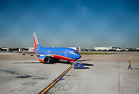 A Southwest Airlines plane prepares for takeoff at Love Field Airport in Dallas, Texas, Wednesday, October 27, 2010...PHOTO/ MATT NAGER