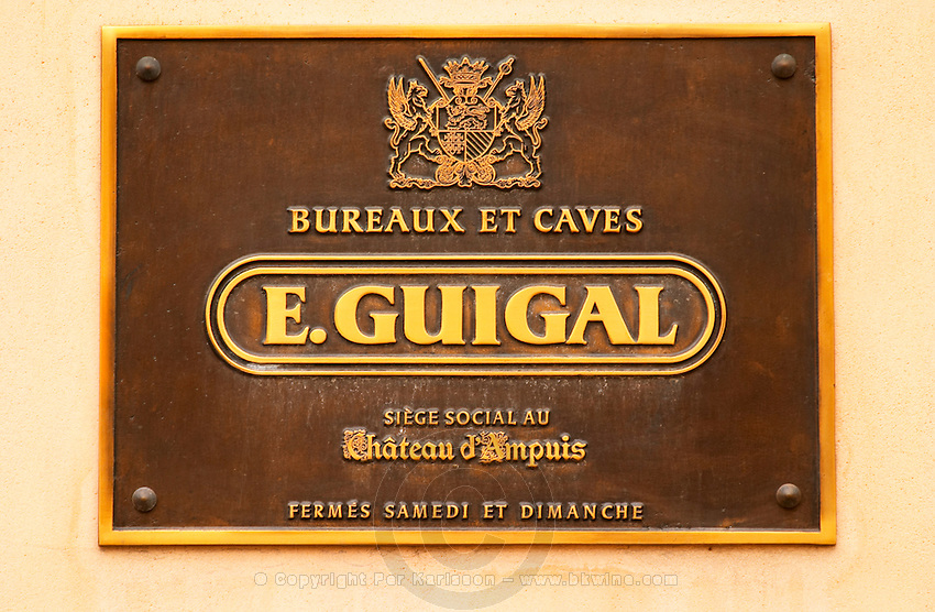 The brass sign at the entrance saying Bureaux et Caves E Guigal Siege Social au Chateau d'Ampuis fermes samedi et dimanche: Offices and winery of Etienne Guigal, registered office at Chateau d'Ampuis, closed Saturdays and Sundays  Domaine E Guigal, Ampuis, Cote Rotie, Rhone, France, Europe