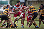 Seluini Molia tries to bust through the Bombay defenders. Counties Manukau Premier Club Rugby game between Bombay and Karaka, played at Bombay, on Saturday March 15 2014. Karaka won the game 39 - 12 after leading 13 - 5 at halftime.  Photo by Richard Spranger