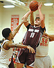 Josh Pismeny #10 of Deer Park draws a shooting foul during a Suffolk County varsity boys basketball game against host Half Hollow Hills West High School on Thursday, Jan. 19, 2017. Deer Park won by a score of 59-49.