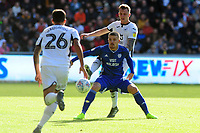 Danny Ward of Cardiff City vies for possession with Ben Wilmot of Swansea City during the Sky Bet Championship match between Swansea City and Cardiff City at the Liberty Stadium in Swansea, Wales, UK. Sunday 27 October 2019