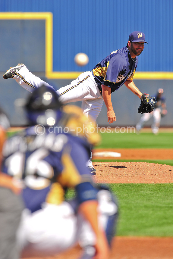 Mar 12, 2011; Tucson, AZ, USA; Milwaukee Brewers pitcher Shaun Marcum (18) watches a pitch in the 2nd inning of a game against the Arizona Diamondbacks at the Maryvale Baseball Park.  The Brewers won 6-4.