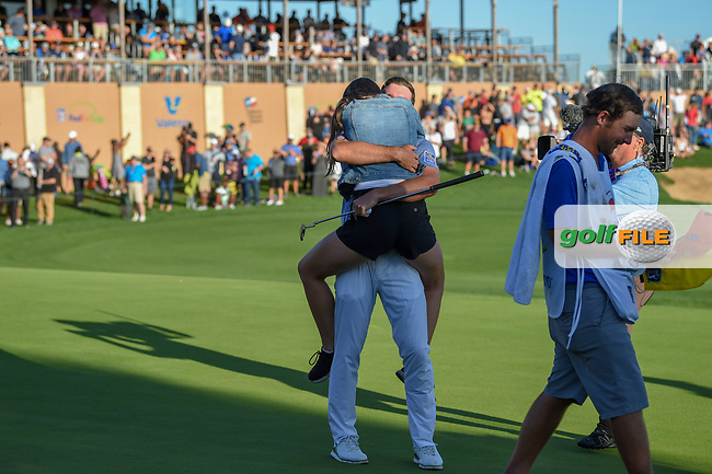 Corey Conners (CAN) hugs his wife, Malory after winning the Valero Texas Open, at the TPC San Antonio Oaks Course, San Antonio, Texas, USA. 4/7/2019.<br /> Picture: Golffile | Ken Murray<br /> <br /> <br /> All photo usage must carry mandatory copyright credit (© Golffile | Ken Murray)