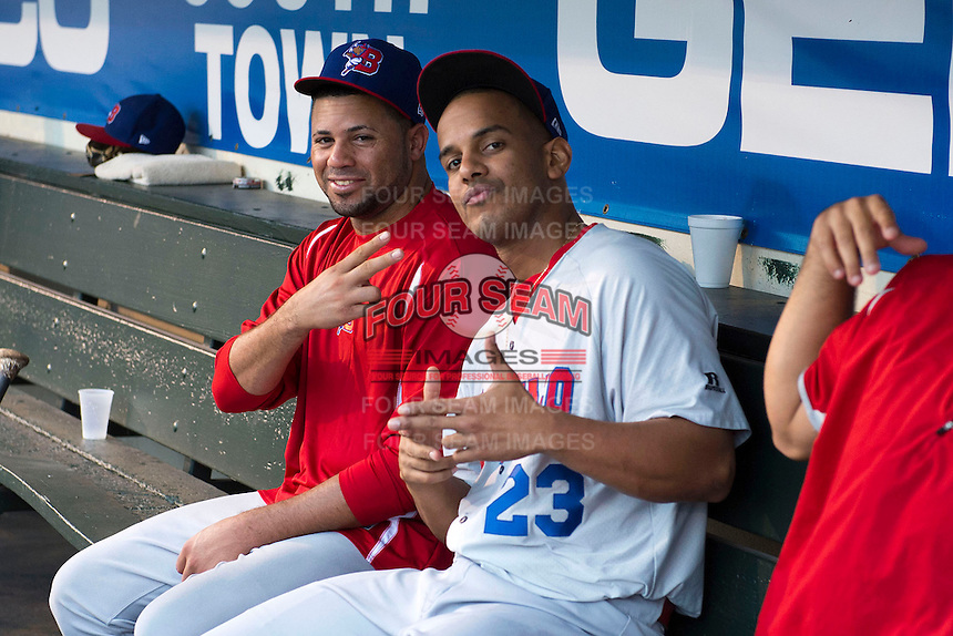 Buffalo Bisons pitcher Luis Perez (11) and outfielder Ricardo Nanita (23) in the dugout during a game against the Rochester Red Wings on August 30, 2013 at Frontier Field in Rochester, New York.  Buffalo defeated Rochester 6-3.  (Mike Janes/Four Seam Images)