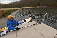 NWA Democrat-Gazette/FLIP PUTTHOFF <br /> CLEANUP BY KAYAK<br /> Rick McLeod (cq) with the Downtown Rogers Rotary Club heads out Saturday April 21 2018 in his kayak to take part in a cleanup day at Lake Atalanta Park near downtown Rogers. Individuals, families and organizations picked up litter throughout the park and along the Lake Atalanta shoreline. The city of Rogers, Ozarks Water Watch, Benton County Extension Office and the Downtown Rogers Rotary Club organized the event.