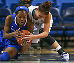 Nevada's MorningRose Tobey and Air Force's Dee Bennett battle for a loose ball in a women's basketball game in Reno, Nev., on Saturday, Jan. 9, 2016. Nevada won 68-57.<br /> Photo by Cathleen Allison