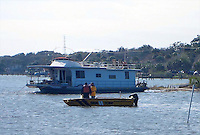 After being stranded on a Holly Hill, Florida sandbar since a storm blew it ashore in October of 2011, a houseboat owned by Robert McGary is refloated by workers on February 8, 2012.  (Photo by Brian Cleary/www.bcpix.com)