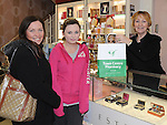 Linda and Kayleigh Tuite get a bargain from Kathleen Vickers at Town Centre Pharmacy as part of the small Business Saturday. Photo: Colin Bell/pressphotos.ie
