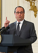 President Francois Hollande of France answers a reporter's question as he and United States President Barack Obama conduct a joint press conference in the East Room of the White House in Washington, DC on Tuesday, November 24, 2015. The leaders agreed on the need to contain ISIL.<br /> Credit: Ron Sachs / CNP