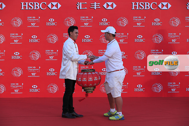 Rickie Fowler (USA) takes part in a Chinese lantern ceremony in front of the Shanghai skyline on the rooftop of the Peninsula Hotel on the Bund after Tuesday's Practice day of the WGC - HSBC Champions 2014 held at Sheshan International Golf Club, Shanghai, China. 4th November 2014.<br /> Picture: Eoin Clarke www.golffile.ie