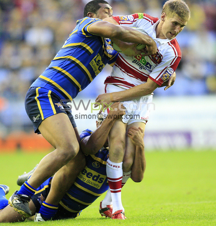 Pix: Chris Mangnall/SWpix.com, Rugby League, Super League. 24/07/09 Wigan Warriors v Leeds Rhinos....picture copyright>>Simon Wilkinson>>07811267 706>>....Wigan's Sam Tomkins  tackled by Leeds's Kylie Leuluai and Jamie Jones Buchanan