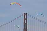 Kite sailing over San Francisco Bay with the Golden Gate Bridge in the background.