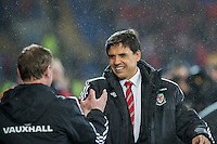 Wales manager Chris Coleman greets Northern Ireland manager Michael O'Neill ahead of the International Friendly match between Wales and Northern Ireland at Cardiff City Stadium, Cardiff, Wales on 24 March 2016. Photo by Mark  Hawkins / PRiME Media Images.