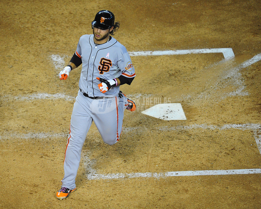 May 13, 2012; Phoenix, AZ, USA; San Francisco Giants base runner Brandon Crawford scores in the fourth inning against the Arizona Diamondbacks at Chase Field. Mandatory Credit: Mark J. Rebilas-