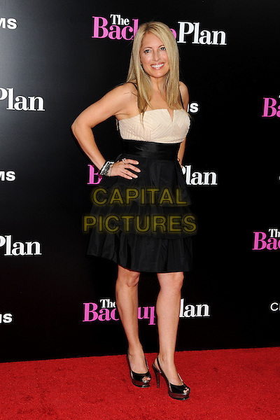 "AMY BLOCK .""The Back-up Plan"" Los Angeles Premiere held at the Regency Village Theatre, Westwood, California, USA,.21st April 2010..arrivals full length black beige cream dress hand on hip peep toe shoes platform bracelets .CAP/ADM/BP.©Byron Purvis/AdMedia/Capital Pictures."