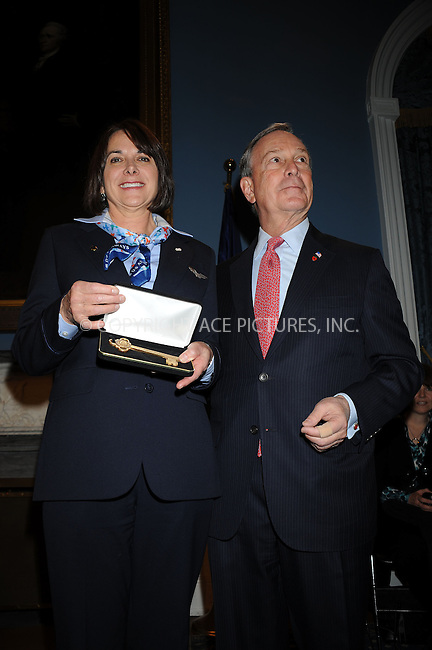 WWW.ACEPIXS.COM . . . . . ....February 9 2009, New York City....New York City Mayor Michael Bloomberg presents the keys to the city to US Airways Flight 1549 Captain Chesley Sullenberger and his crew in recognition of their extraordianry achievement of crash-landing thier aircraft on the Hudson River with no loss of life at City Hall on February 9 2009 in New York City. ......Please byline: KRISTIN CALLAHAN - ACEPIXS.COM.. . . . . . ..Ace Pictures, Inc:  ..tel: (212) 243 8787 or (646) 769 0430..e-mail: info@acepixs.com..web: http://www.acepixs.com