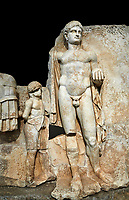 Close up of a Roman Sebasteion relief  sculpture of Emperor Nero with captive, Aphrodisias Museum, Aphrodisias, Turkey.   Against a black background.<br /> <br /> Naked warrior emperor Nero holds the orb of world rule in one hand and crowns the military trophy with the other. Between the trophy and the emperor stands a bound captive boy. He wears long barbarian trousers and looks up at Nero.