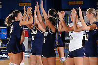 13 September 2008:  FIU defensive specialist Angela Colon (4) high-fives with her teammates during player introductions prior to the FIU 3-0 (25-11, 25-19, 25-19) victory over Penn in the 2008 FIU Invitational tournament at Panther Arena in Miami, Florida.