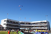 Sept. 22, 2013; Ennis, TX, USA: A sky diver parachutes in with the American flag before the first round of NHRA eliminations during the Fall Nationals at the Texas Motorplex. Mandatory Credit: Mark J. Rebilas-