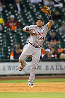 Detroit Tigers third baseman Miguel Cabrera (24) leaps for a line drive during the MLB baseball game against the Houston Astros on May 3, 2013 at Minute Maid Park in Houston, Texas. Detroit defeated Houston 4-3. (Andrew Woolley/Four Seam Images).
