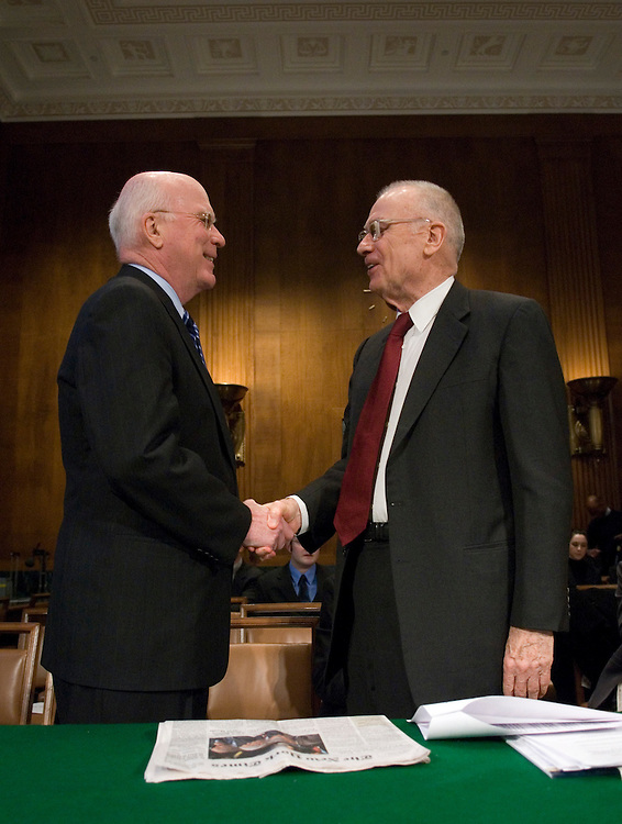 Committee chair Patrick Leahy, D-Vt., greets Lee Hamilton, right, vice chair of the Iraq Study Group, before the start of the Senate Judiciary Committee hearing on improving Iraq's judicial system on Wednesday, Jan. 31, 2007.