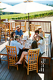 USA, Oregon, Willamette Valley, a group of travelers enjoy some wine and conversation outside on the patio at Domaine Drouhin Winery, Dundee