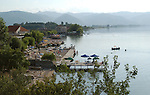 Tushemisht-Pogradec-Albania - August 02, 2004---Beach and tourists at Lake Ohrid; region/village of project implementation by GTZ-Wiram-Albania (German Technical Cooperation, Deutsche Gesellschaft fuer Technische Zusammenarbeit (GTZ) GmbH); environment-landscape-tourism---Photo: Horst Wagner/eup-images