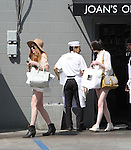 April 9th 2012 ...Lindsay & Ali Lohan leaving Joans on Third restaurant in Los Angeles driving a black 4 door Porsche. Lindsay was complaining about how hot it was showing off her long legs in short shorts wearing a big hat & carrying a huge white designer purse & to-go food bags. ...AbilityFilms@yahoo.com.805-427-3519.www.AbilityFilms.com..